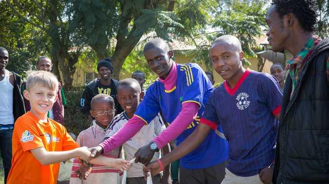 Fletcher Scott meets his new footballing friends after arriving in Tanzania.