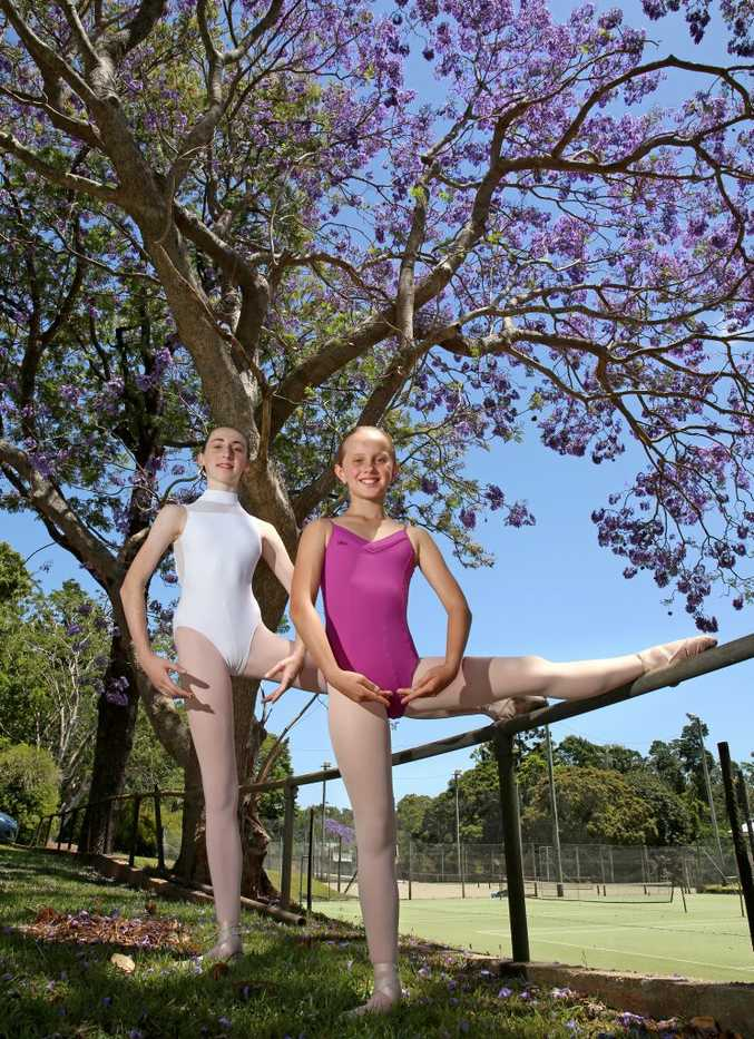 Ballet dancers Lily Kate Folpp and Jacqueline Samms stretching outside Susan Whiteman's dance studio in Alstonville.
