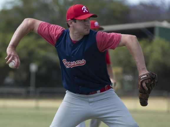 ON THE MONEY: Toowoomba Rangers' pitcher Shaun Clarke throws to first base during play against Redlands.