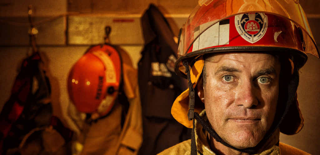 TOUGH JOB: Fire Rescue NSW Grafton station officer Col Drayton reflects on the fire that tore through Big River Timbers on Wednesday morning. PHOTOS: ADAM HOURIGAN