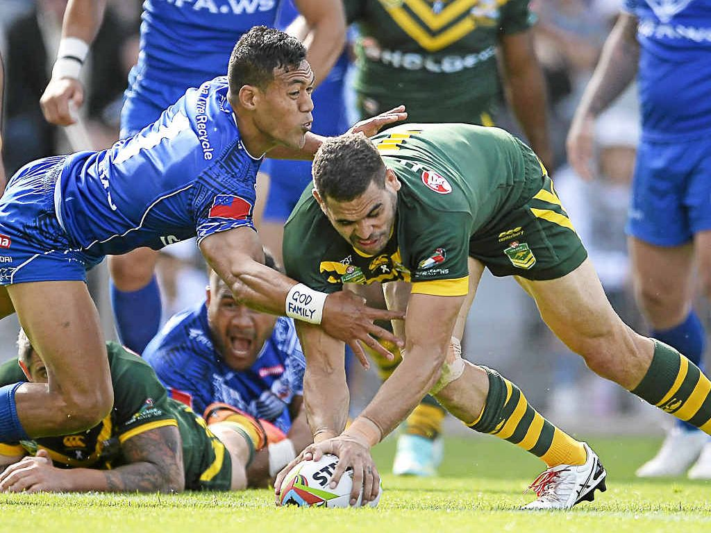 Australia's Greg Inglis scores a try in the win over Samoa yesterday.