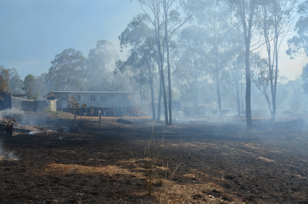 A grass fire in Booie on Sunday got within metres of a home.