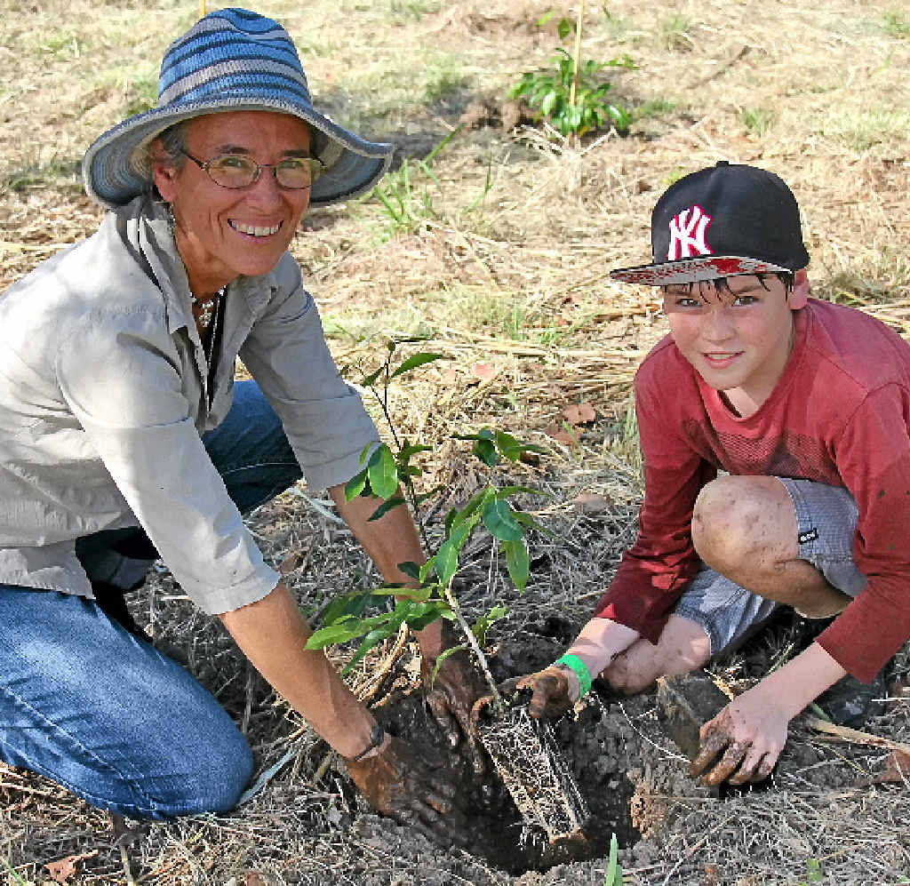 SAVING THE VALLEY: Eva Ford and Jacob Sprecher, of the Mary River Catchment Co-ordinating Committee, carry on the work of saving the Mary Valley by planting trees at Kandanga.