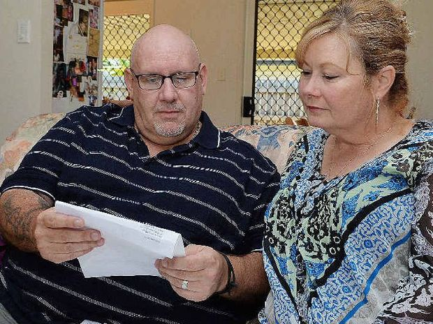 Steve Anderson and wife Monique sort through correspondence regarding Steve's condition at their Mackay home.