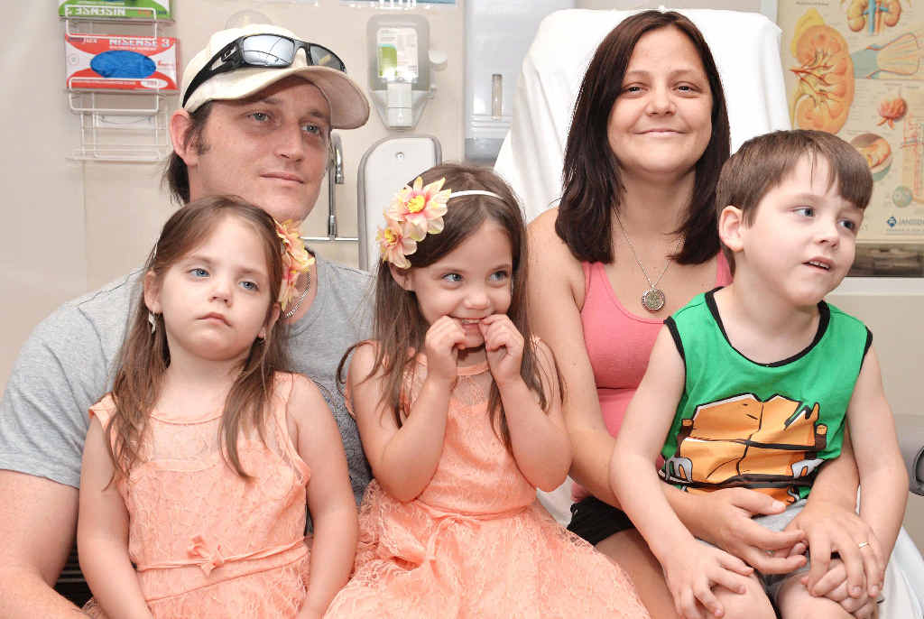 OPTIMISTIC: Moranbah family Chris and Kathy Abbott with their children Emily, Phoebe and Noah. Kathy has diabetes and cancer and requires a kidney and pancreas transplants in Sydney.