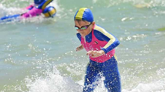 MAKING A SPLASH: Ben Dollery, 10, at Tannum Sands beach for the local club's first major carnival of the season.
