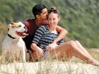 BRAVE: Nadine White, who is battling brain cancer, with her fiance Travis Meyn and dog Norman at Tallebudgera.