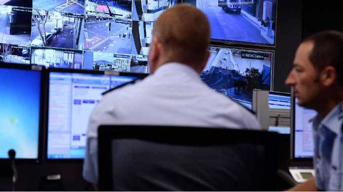 BIG BROTHER: Police officers monitor surveillance camera vision at the newly established G20 Operations Centre in Brisbane.
