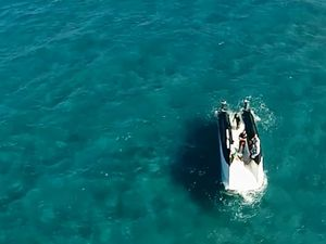 VIDEO: Five men rescued from upturned boat