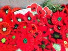 Handmade poppies line the base of the war memorial in Maryborough on Remembrance Day.