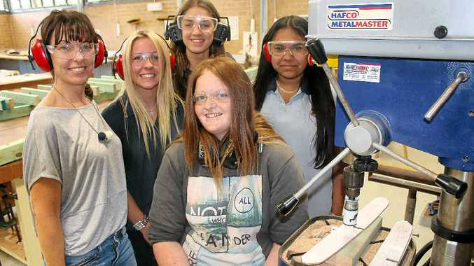 ROAD LESS TRAVELLED: (Back from left) Tiffany Bennett from Connect, Emily Lewis, Grace Lewis, Loren Del Signore and (seated) Jessica Meade attend the Trading Places program launch in a Ballina High School trades room.