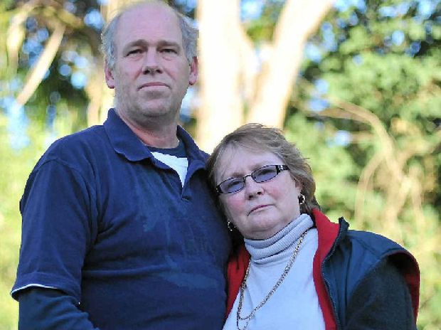 SAD LOSS: Brett and Bonnie Scovell are distraught after the death of their 21-year-old son Sean (below right) at his workplace.