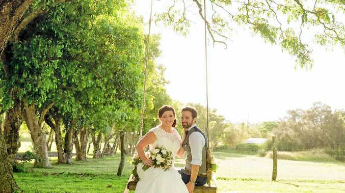 HAPPY DAY: Carl and Janelle Jensen got into the island swing during their wedding.