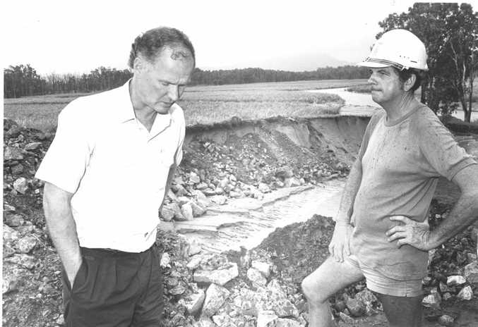 Premier Mr Wayne Goss visiting Mackay during The Big Wet of 1990/91 and spoke with canegrower Ray Geisler in late December.
