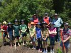 The keen group of Year 5 students from Concordia at Darling Downs Zoo planting trees with the Junior Landcare Lockyer Valley and Toowoomba group.
