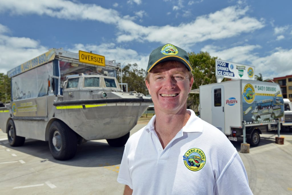 Trying to drum up business: Craig Seeley with his food van and amphibious boat, Golden Beach, Caloundra.