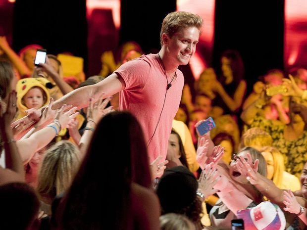 Big Brother evictee Richard Hordern-Gibbings greets fans at Dreamworld.
