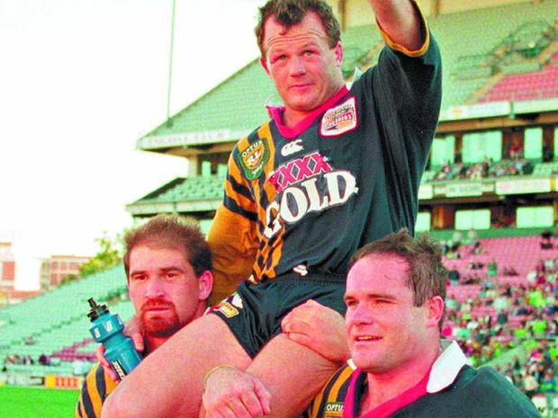 Trevor Gillmeister of the Crushers is chaired off the ground by teammates after playing his last match for the South Queensland Crushers.