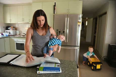 Jacci Sharkey was able to finish her university degree juggling two children and a husband. Jaccci is pictured with her partner Chris and baby Alek,11 weeks, and son Ari,1 and a half. Photo: Warren Lynam / Sunshine Coast Daily