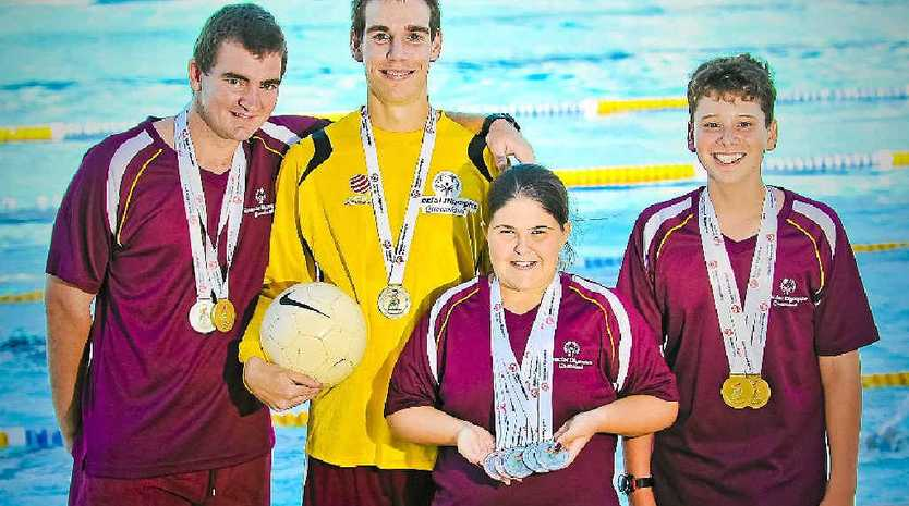 PROUD: Kerrod Hamilton, Adam Knust, Ruby Lawler and Jarrod Lee, 13, all won medals at the Special Olympics Australia National Games.