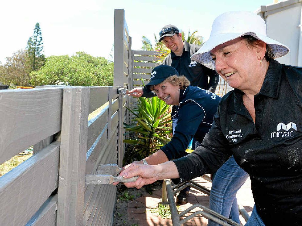 PRETTY SLICK: Lending a hand to spruce up the Kawana Waters Surf Club are Mirvac employees Brendon Russo, Liz Brant and Lynne Watson.
