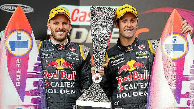 WINNERS: Jamie Whincup and Paul Dumberell celebrate winning the Gold Coast 600 last month.