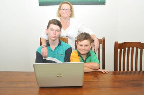 Benaraby family Drew, 13, Owie, 9, and Katherine Kennett say not having internet for nearly a week was a huge inconvenience.