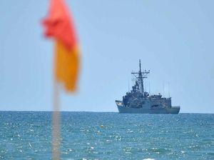 As Russian warships circle HMAS Sydney sits off the Coast