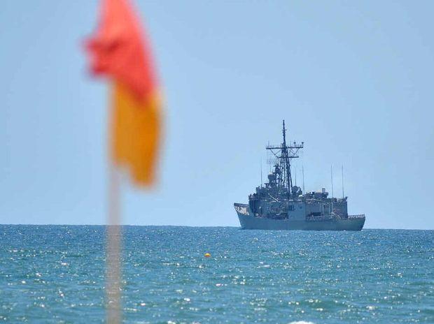 WHAT'S SHE DOING: HMAS Sydney off the Sunshine Coast, taken at Alexandra Headland.