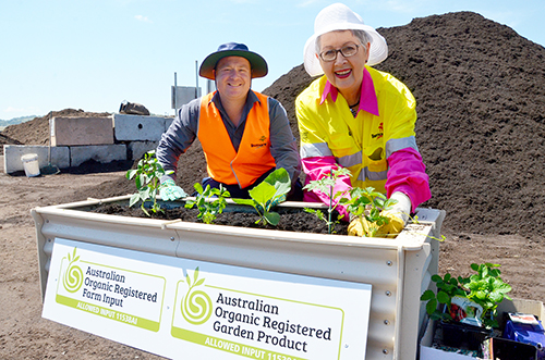 Mayor Jenny Dowell and Waste Operations Coordinator Kevin Trustum planting a vegetable garden using the certified organic compost.