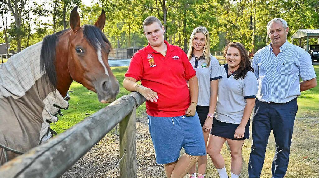 AT HOME: Race car driver Brock Giblin is recovering at home after a serious crash put him in hospital. There to help him recover are Hannah, Tyla and dad Peter.