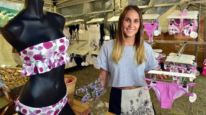 IN THE PINK: Abby Vuister, of Abby Rose Bikinis, at her Eumundi Markets store.