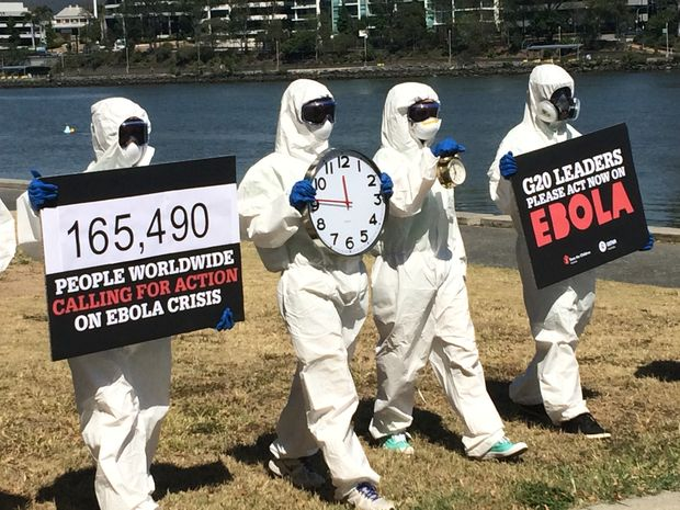Oxfam and Save the Children staff and volunteers dress in protective gear at Riverside Park, Brisbane, to call on G20 leaders to join together to get Ebola under control.