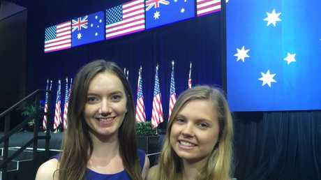 Griffith University students Megan Currey, from Mackay, and Jessica Lawrie, from Rockhampton, at United States President Barack Obama's speech at University of Queensland ahead of the G20 Leaders' Summit. Photo Rae Wilson / Newsdesk