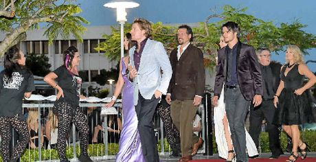 The cast arrives on the red carpet.