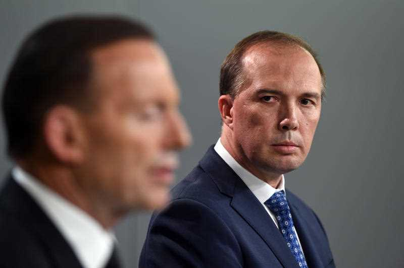 Minister Peter Dutton has showed he has exceptional reflexes, dodging a shoe to the head from a protester.