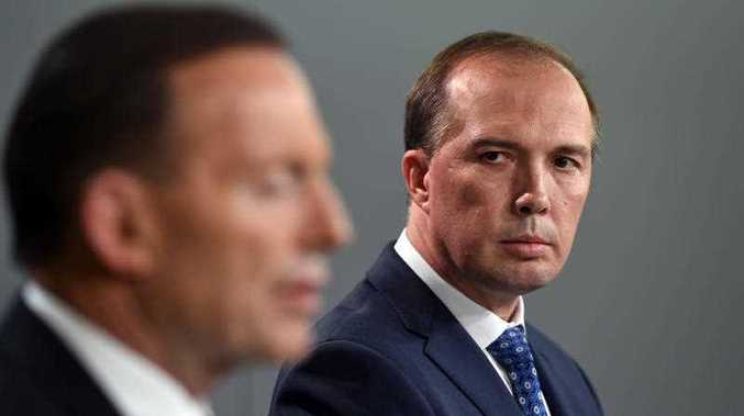 Australian Prime Minister Tony Abbott (left), and Health Minister, Peter Dutton, answer a question at a press conference in Sydney on Wednesday, Nov. 5, 2014. The Commonwealth Government will increase Australia's $18 million contribution to the response to Ebola in West Africa and strengthen preparations to detect and respond to a possible Ebola case in Australia.