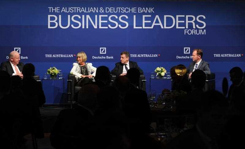 ANZ Group CEO Mike Smith, Spotless Chairman Margaret Jackson, Wesfarmers commercial director Ian MacLeod and journalist Eric Johnson have a discuss on stage at a Business Leaders Forum at Mural Hall in Melbourne, Friday, Oct. 17, 2014. The business leaders spoke about continuing volatility in the global economy.