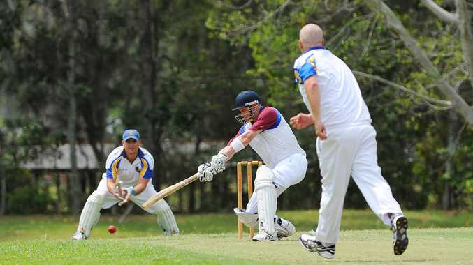 Diggers batsman Gus Garland despatches a delivery from former Sawtell team mate Brad Lewis in the grand final replay at Fitzroy Oval.