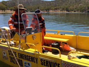 The State Emergency Service searching Eungella Dam for the missing man.
