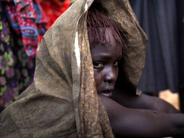 Pictures from a Pokot ceremony show young girls being cut in ritual