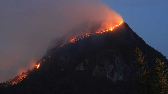 SCN111114BURNING Caption: A bushfire burns out of control in scrubland on top of Mt Cooroora.