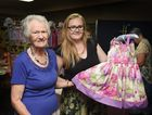 Hervey Bay Crafters' Christmas craft fair - Pam Jackson and Hayley McCoy admire a dress by Lorna Jones.