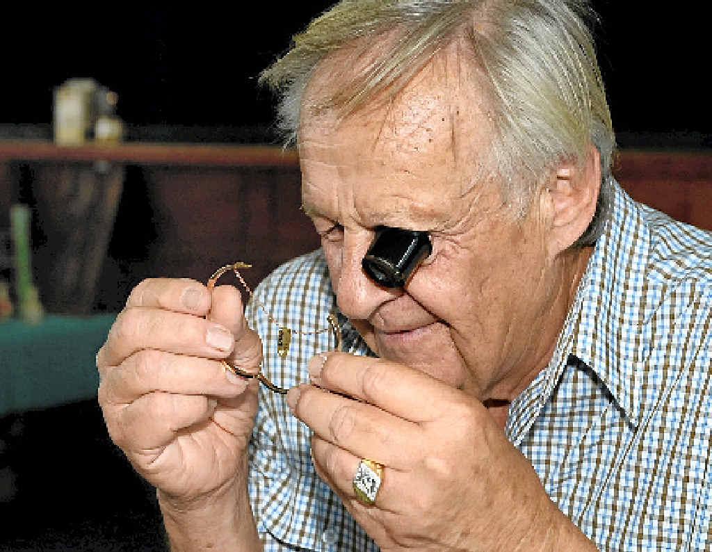 Bob Goodyear checks the quality of a bracelet.