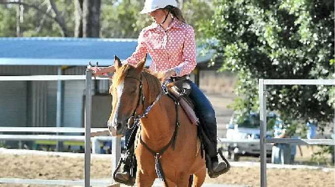 RIDE ON: Shahni Hornery riding Bree at the Silver Spurs Western Performance and Quarter Horse Club introduction event.
