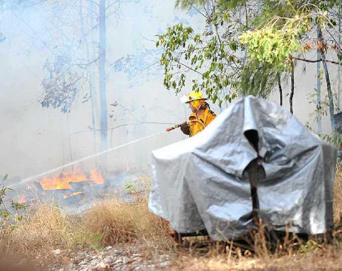Controlling a blaze at Kiamba.