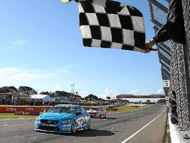 DRIVE BY: Scott McLaughlin gets past Garth Tander on the finish line to win at Phillip Island yesterday.