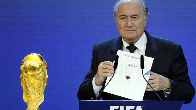FIFA President Sepp Blatter holding up the name of Qatar during the official announcement of the 2022 World Cup host country at the FIFA headquarters in Zurich. Football's world governing body FIFA has cleared on November 13, 2014 the 2022 World Cup hosts Qatar of corruption and ruled out a re-vote to decide the host of the competition despite widespread allegations of wrongdoing.