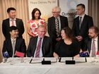 FULL STEAM AHEAD: Deputy Premier Jeff Seeney and mining magnate Gina Rinehart sign the Memorandum of Understanding which commits both parties to fully pursue the $500 million Mary Valley processing plant and South Burnett dairy farm. Contributed.