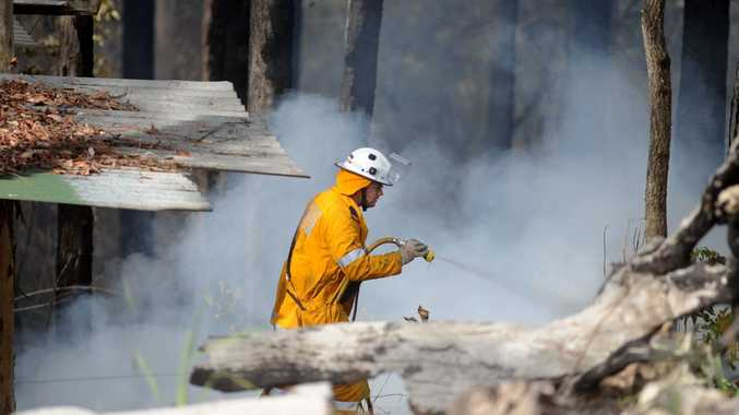 Bush fire at Kiamba. Rural Fire brigade members and the water bombing helicopter were called to put out the fire. Photo: Warren Lynam / Sunshine Coast Daily